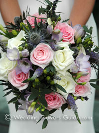 Summer seasonal wedding flowers, bouquet of roses and chrysanthemums