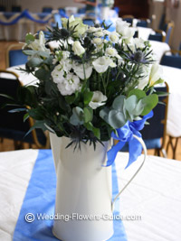 vintage jug with white flowers for blue theme wedding