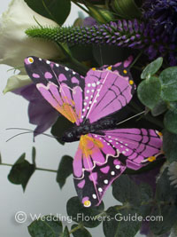 wedding butterfly accessory on flowers