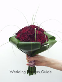 black baccara rose in a wed hand-tied bridal bouquet