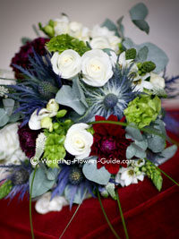 Blue Thistle Wedding Bouquet With White Roses