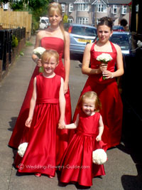 bridesmaids and flowergirl being a wedding