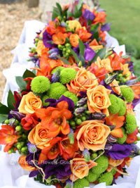 Real weddings lindsays purple and orange wedding flowers delivering fall wedding flowers for an autumn wedding junglespirit Images