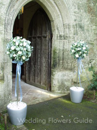 Flower Topiary Tree Which Coordinates With Wedding Ceremony Flowers
