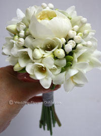 flowergirl's peony freesia bouquet in white
