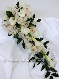 Close up of lily and cymbidium orchid wedding bouquet