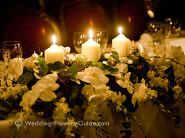 candle and orchid top table arrangement