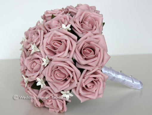 Silk bridal bouquet created with pink roses and white stephanotis