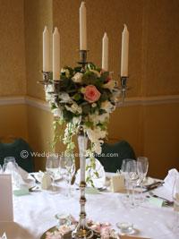 Rose Decorated Candelabra As Wedding Centerpiece