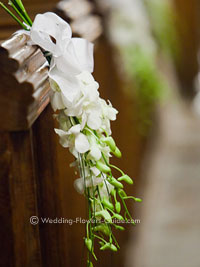 Singapore orchid pew ends used in a church wedding