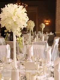 tall white lily centerpieces at a wedding