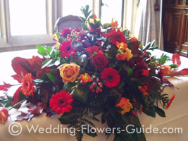 Wedding flowers for top table at an October wedding