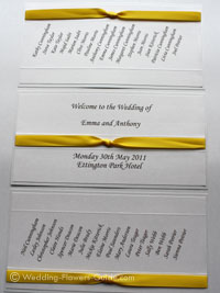 wedding seating plan decorated with yellow ribbon
